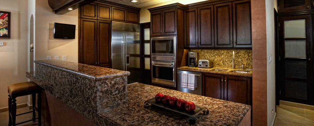 Beautifully appointed rooms with elegant furnishings and kitchen appliances